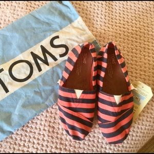 TOMS pink chambrey stripe youth classic shoes